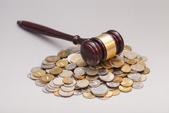 Judges law gavel on pile of coins Royalty Free Stock Images