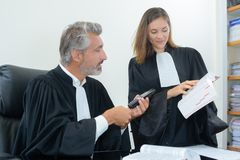 Judges reading law book royalty free stock photo