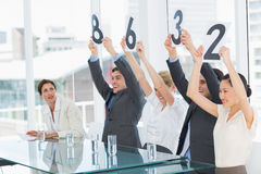 Judges in a row holding score signs Stock Photography