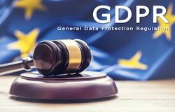 Judges wooden gavel with EU flag in the background with text GDP Stock Photos