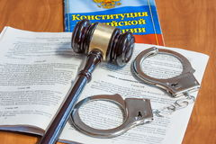 Judicial hammer, codes of laws  and handcuffs Royalty Free Stock Photos