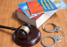 Judicial hammer, handcuffs and codes of laws Royalty Free Stock Photos