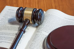 The judicial hammer lays on the  book Stock Photo