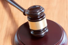Judicial hammer  on a wooden table Stock Photography