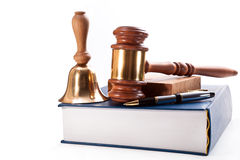 A judicial inquiry. Gavel, bronze bell, book and pen on a white background Stock Photo