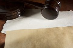 Judicial wooden hammer. And old documents on the table royalty free stock photo