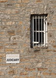 Judiciary Parking and Jail Window. A barred window and judiciary parking sign at the courthouse and jail in Perth, Ontario, Canada royalty free stock photography