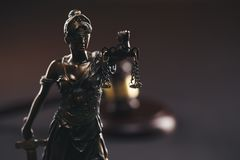 Judje gavel and statue of Justice isolated. stock photos