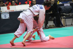 Judo. Two girls in a fight of Judo during the 24 international tournament in Genoa on 21 and 22 April 2012 royalty free stock photography