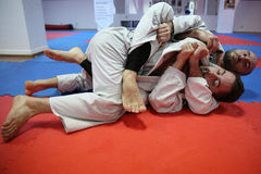 Judo action - submission technique. Judo action: unknown male judo fighters performing a submission technique stock image