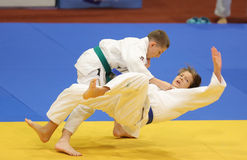 Judo action - throwing maneuver. Judo action: unknown judo fighters performing during the European Judo Championships for Individual Juniors held in Bucharest stock image