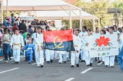 Judo athletes at the celebration of the 119 years of Campo Grand. Campo Grande, Brazil - August 26, 2018: Civic Parade desfile civico at 13 de Maio street. Judo royalty free stock photo