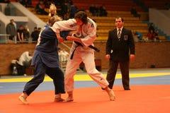 Judo championship. KHARKIV, UKRAINE - NOVEMBER 28:  Unidentified participants scramble within Ukrainian judo championship, November 28, 2009 in Kharkov, Ukraine Stock Images