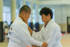 Judo Class at Shudokan Hall in Osaka, Japan. OSAKA, JAPAN - OCTOBER 25: Shudokan Hall in Osaka, Japan on October 25, 2014. Unidentified Japanese students attend royalty free stock photos