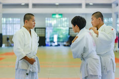 Judo Class at Shudokan Hall in Osaka, Japan. OSAKA, JAPAN - OCTOBER 25: Shudokan Hall in Osaka, Japan on October 25, 2014. Unidentified Japanese students attend royalty free stock photo