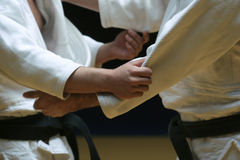 Judo fight. Ers sparring off in a battle of body and mind - selective focus and visible grain Stock Photos