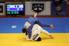 Judo fighters. Firudin Dadashov (in blue) from Azerbaijan and Beka Gviniashvili (in white) from Georgia fighting during the The Judo European Championships for stock photos