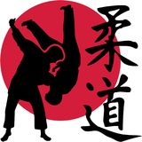 Judo Fighters In Front Of Red Circle With Kanji Signs Stock Photo