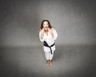 Judo girl unbelievable face Stock Photos