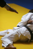 Judo match. Judo referee signalling for a win - selective focus and visible grain stock photography