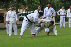 Judo. Police practicing Judo in the city of Solo, Central Java, Indonesia royalty free stock photo