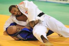 Judo - Roy Meyer y Magomed Nazhmudinov Imágenes de archivo libres de regalías