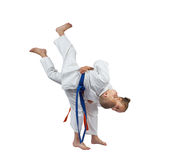 Judo throw in perfoming sportswoman with an orange belt Stock Photos