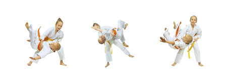 Judo Throws are doing children collage. Judo Throws are doing children in judogi collage Royalty Free Stock Photography