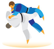 Judo Tournament. The wrestler rolls over back Royalty Free Stock Photography