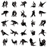Judo wrestlers silhouette set icons, simple style. Judo wrestlers silhouette set icons in simple style on a white background Royalty Free Stock Photography