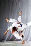 In judogi two athletes doing judo throws Royalty Free Stock Images