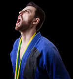 Judoka fighter man - Sports themes Royalty Free Stock Photography