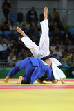 Judoka fighters during fight in judo competitions Royalty Free Stock Photo