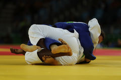 Judoka fighters during fight in judo competitions Royalty Free Stock Photos
