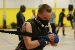 Judoka training with HPVT mask. HPVT (High Performance Ventilation Training) masks reduce the amount of oxygen that can enter the lungs for two purposes: 1) When Stock Photos