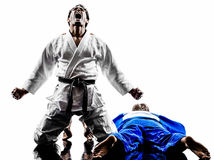 Judokas fighters fighting men silhouettes Royalty Free Stock Image