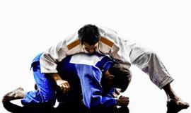 Judokas fighters fighting men silhouettes Royalty Free Stock Photos