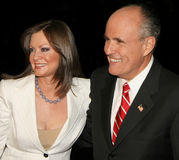 Judy Nathan Giuliani and Rudy Giuliani. Former New York mayor Rudy Giuliani and his wife, Judy Nathan Giuliani, arrive on the red carpet for the premiere of Royalty Free Stock Photography