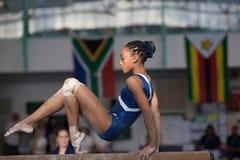 Jueces del haz de la muchacha del finalista del gimnasta fotos de archivo