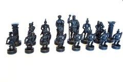 Juego de ajedrez de piedra en el fondo blanco foto de archivo libre de regalías