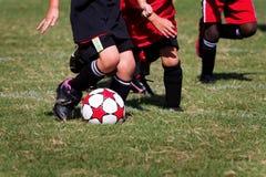 Juego de fútbol de los niños Imagen de archivo libre de regalías
