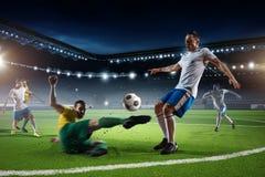 Juego de fútbol en la acción Técnicas mixtas Imágenes de archivo libres de regalías