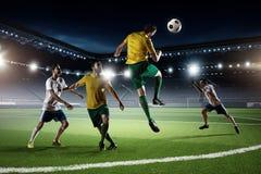 Juego de fútbol en la acción Técnicas mixtas Imagen de archivo libre de regalías