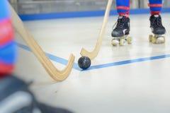 Juego de hockey del rodillo del primer Imágenes de archivo libres de regalías