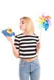 Juego de la muchacha con los juguetes y el molino de viento del color aislados Imagen de archivo