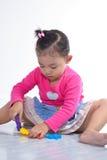 Juego de la niña. Imagenes de archivo
