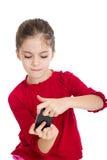 Juego de la niña con smartphone Imagen de archivo