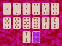 Juego de las tarjetas que juegan de los diams en fondo púrpura Imagen de archivo libre de regalías