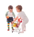 Juego de los niños en tienda Foto de archivo