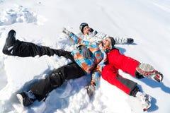 Juego de los pares en nieve Fotografía de archivo